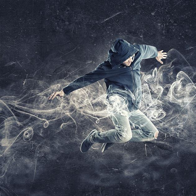 Photo of man in hoodie jumping