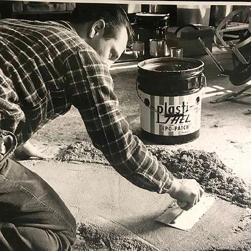 Photo of man smoothing epoxy on floor